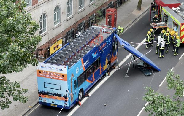 'Like a bomb going off': Roof ripped off tourist bus as it crashes into tree in Bloomsbury